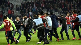 Greek club PAOK owner invades pitch armed, Lille fans attack players