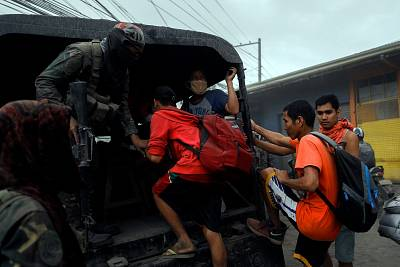 Residents living near the erupting Taal Volcano are evacuated on Monday.
