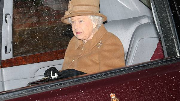 Image: Britain's Queen Elizabeth II departs from church on the Sandringham