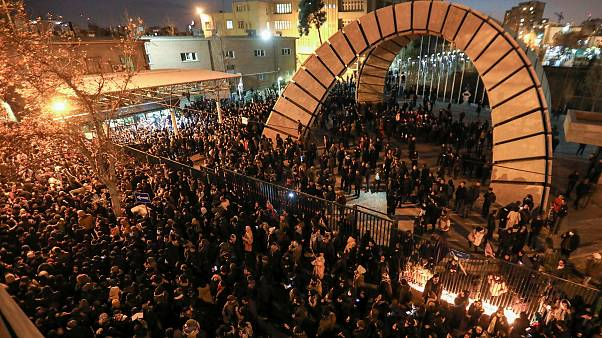 Image: Iranians students demonstrate following a tribute for the victims of
