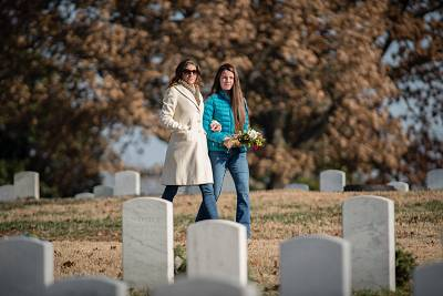 Darren LaBonte\'s widow, Racheal LaBonte, and their 12-year-old daughter visit his grave in Arlington National Cemetery.