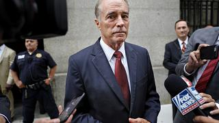 Image: Rep. Chris Collins, R-N.Y., leaves court after a pre-trial hearing i
