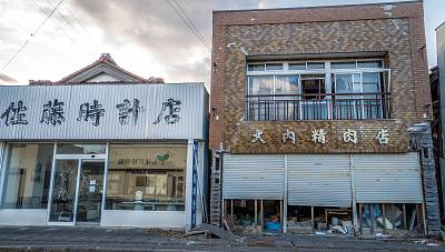 Futaba\'s clock shop, left, and butcher shop in the still uninhabitable town.