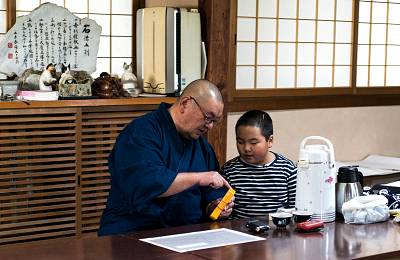 Buddhist priest Sadamaru Okano looks at Geiger counters and radiation charts with his 11-year-old son, Sadahrio, at his temple in Matsukawa, Japan.