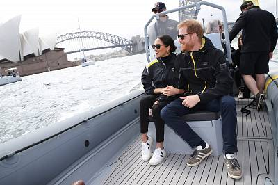 Prince Harry, Duke of Sussex and Meghan, Duchess of Sussex, look out at the Sydney Opera House while on Sydney Harbour during the Invictus Games in 2018.