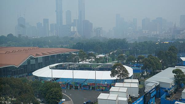 Image: The city skyline shrouded by smoke haze from bushfires during an Aus