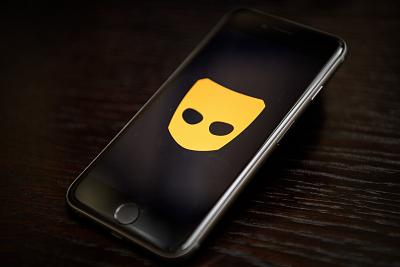 "The ""Grindr"" app logo is seen on a mobile phone screen."