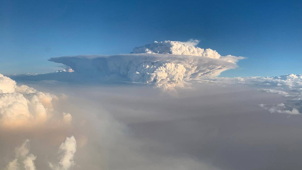 Image: Pyrocumulonimbus cloud formation is seen from a plane as bushfires c