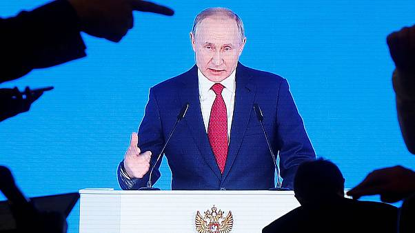 Image: Russian President Vladimir Putin delivers his annual state of the na