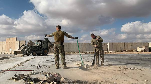 Image: U.S. soldiers clearing rubble at Ain al-Asad military airbase in the