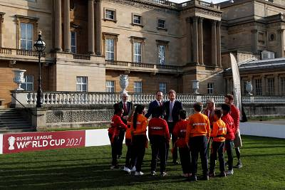 Prince Harry speaks to young rugby players at Buckingham Palace.