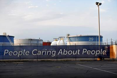 A banner outside of the Philadelphia Energy Solutions refinery on Aug. 21, 2019.