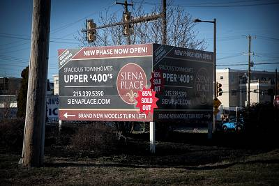 A sign advertising new townhouses built less than 1,000 feet from the Philadelphia Energy Solutions refinery site.
