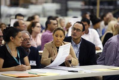 Volunteers look at ballots during a hand recount at the Supervisor of Elections Service Center in Palm Beach, Florida, on Nov. 18, 2018.