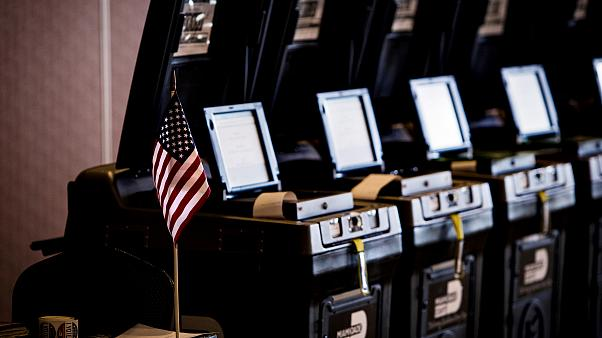 Image: Voting machines at a polling station in Doral, Fla., on Aug. 28, 201