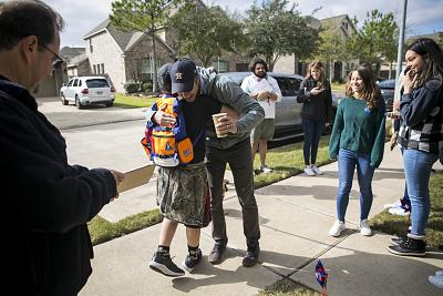 Beto O\'Rourke greets Tyler Vaughn, 12, outside a home in Katy, Texas, on Jan. 11.