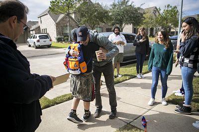Beto O\'Rourke greets Tyler Vaughn, 12, outside a home in Katy, Texas, on Jan. 11.