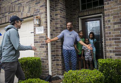 Chibuzo Nlechi greets Beto O\'Rourke as O\'Rourke knocks on doors for Eliz Markowitz in Richmond, Texas, on Jan. 11.