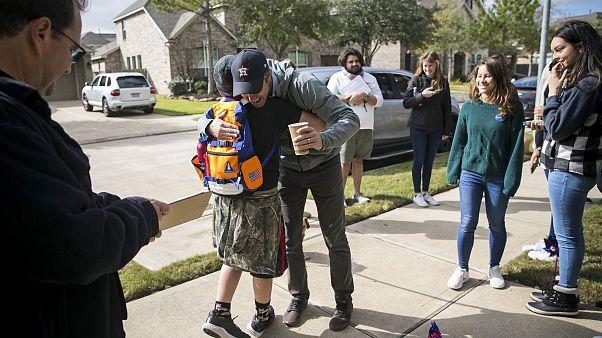 Beto O'Rourke greets a boy in Katy, Texas