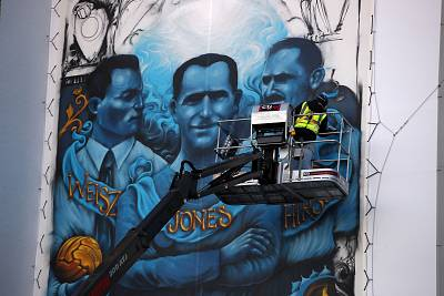 Artist Solomon Souza paints the Holocaust Commemorative Mural at Stamford Bridge on Jan. 15, 2020 in London, England.