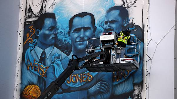 Image: Artist Solomon Souza paints the Holocaust Commemorative Mural at Sta