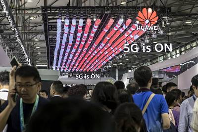 Attendees walk past the Huawei Technologies Co. booth at the MWC Shanghai exhibition in Shanghai, China in June.
