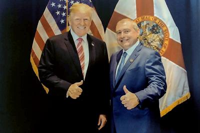 This undated image released by the House Judiciary Committee from documents provided by Lev Parnas to the committee in the impeachment probe against President Donald Trump, shows a photo of Lev Parnas with Trump in Florida.