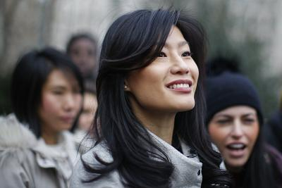 Evelyn Yang, wife of Democratic presidential candidate Andrew Yang, attends a rally before the Women\'s March on Saturday in New York.