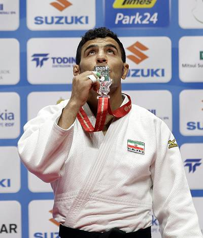Bronze medalist Iran\'s Saeid Mollaei celebrates on the podium in the mens 81kg category at the World Judo Championships in Budapest on in 2017.