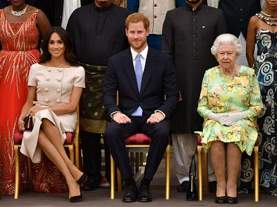 In an archive shot, Britain\'s Queen Elizabeth, Prince Harry and Meghan, the Duchess of Sussex, pose for a picture at in London, Britain.