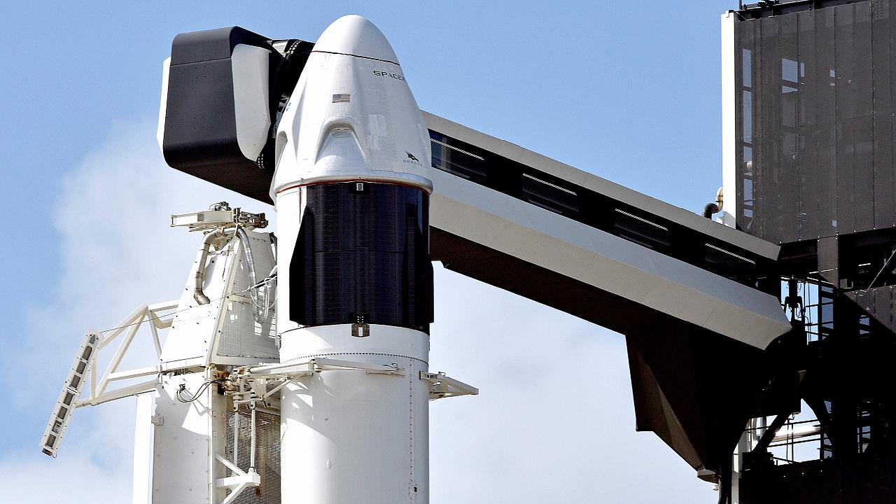 Image: The SpaceX Crew Dragon capsule sits atop a Falcon 9 booster rocket o