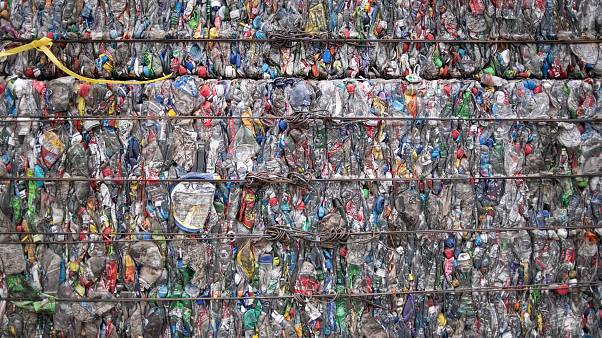 Image: A block of compressed plastic at a plastic waste center on the outsk