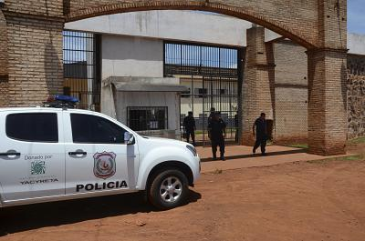 Police stand guard at Pedro Juan Caballero city jail in Paraguay on Jan. 19, 2020.