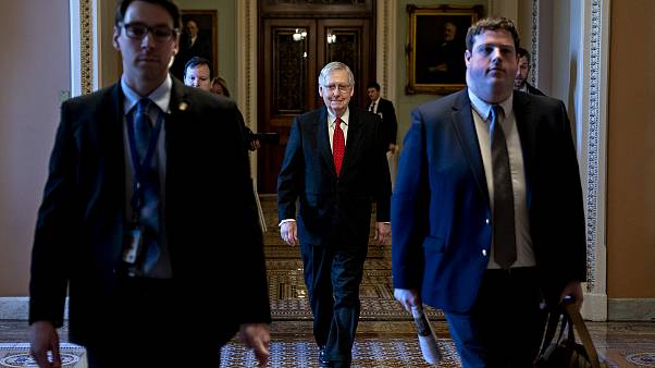 Senate Majority Leader Mitch McConnell arrives to the Capitol on Jan. 21, 2
