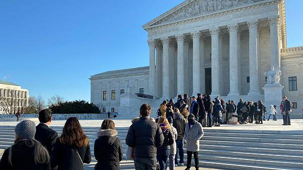 Image: People line up outside the Supreme Court ahead of oral arguments in