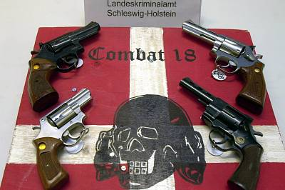 Weapons and a sign of neo-Nazi group Combat 18 seized by the police in Kiel, northern Germany.