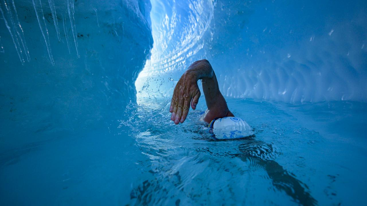 Lewis Pugh trains in a river under the Antarctic ice sheet, as he prepares