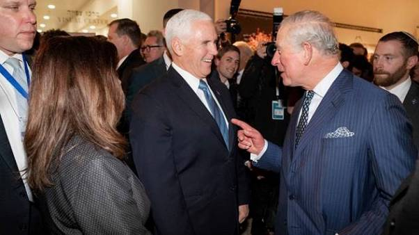 Vice President Mike Pence and Prince Charles talk before an event at the Ya