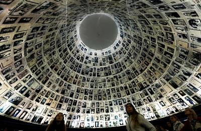 Visitors look at the Hall of Names, a repository for the names of millions of Holocaust victims at the Yad Vashem memorial center in Jerusalem.