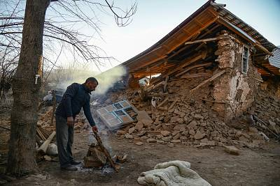 A villager stands by his collapsed house after an earthquake in Sivrice, near Elazig, eastern Turkey, on Saturday.