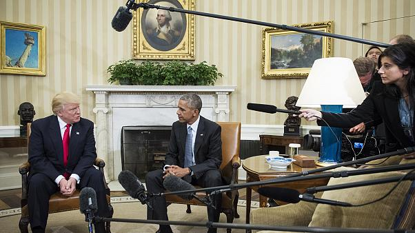 President Barack Obama talks with President-elect Donald Trump in the Oval