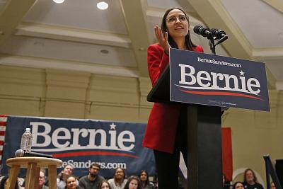 Rep. Alexandria Ocasio-Cortez, D-N.Y., speaks as a surrogate for Democratic presidential candidate Bernie Sanders on Jan.24, 2020, in Iowa City.