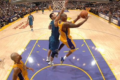 Kobe Bryant of the Los Angeles Lakers attempts a shot against Yi Jianlian of the Washington Wizards at Staples Center on Dec. 7, 2010 in Los Angeles, California.