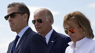 Image: U.S. Vice President Joe Biden, centre, his son Hunter Biden, left, a