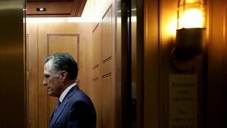 Image: Sen. Mitt Romney, R-Utah, leaves after a vote at the Capitol on Dec.