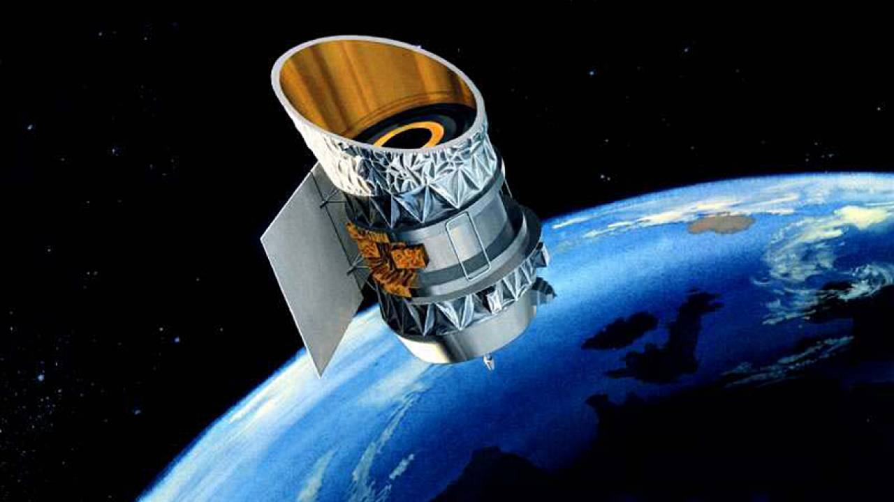 The Infrared Astronomical Satellite RAS) orbits the Earth in this illustrat