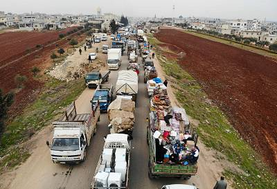 Displaced Syrians driving through Hazano in the northern province of Idlib on Jan. 28, 2020.