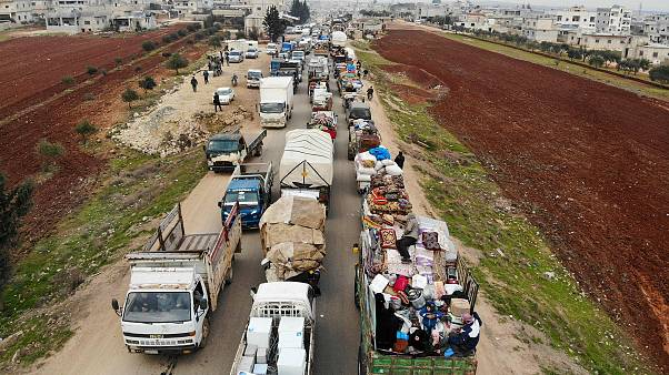 Image: Displaced Syrians driving through Hazano in the northern province of