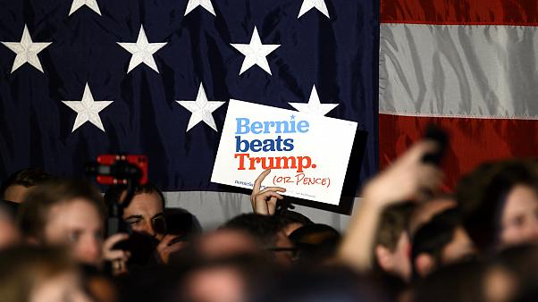 Image: Supporters wave signs for Sen. Bernie Sanders, I-VT, at a campaign e