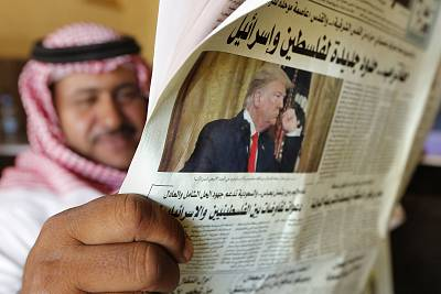 A man holds the daily Asharq Al-Awsat newspaper that features a picture of President Donald Trump on its front page, in Jiddah, Saudi Arabia, on Wednesday.